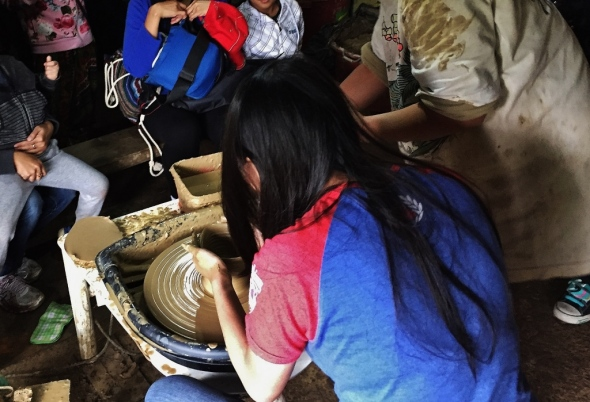 Demonstrating how pottery is made