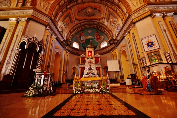 the church interiors featuring the magnificent altar