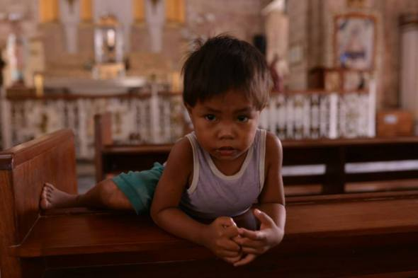 I will never forget this boy who once sat in front of my pwe as I prayed. Maybe a Sto Nino?