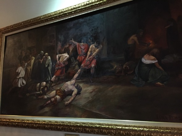 a reproduction of Juan Luna's Spoliarium